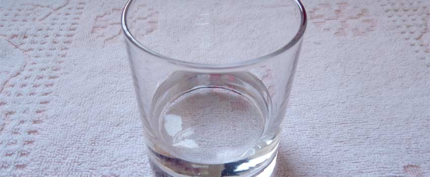 Glass of saltwater solution.